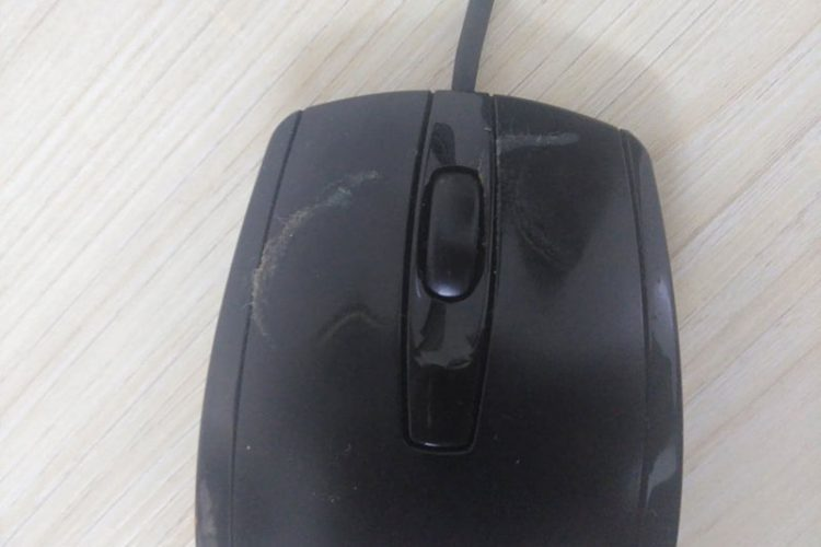 a dirty computer mouse with sticky buttons